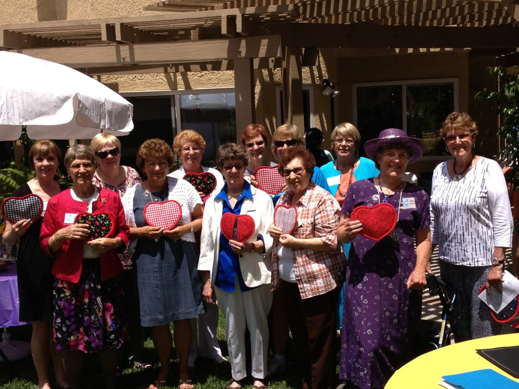 Simi Valley Branch 2012-13 board at annual brunch, showing off their heart presents from President Ruth Dempsey. A wonderful day, experienced by a large gathering to honor scholarship and Tech Trek recipients.